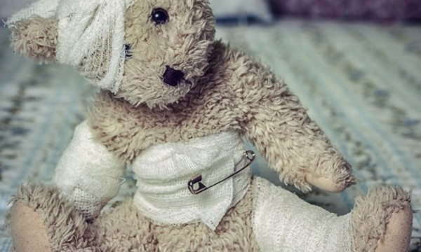 a wounded teddy bear with dressings