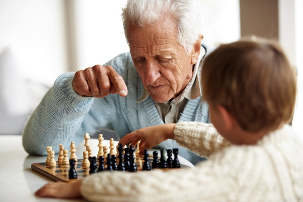 Teaching his grandson about chess
